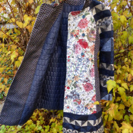 A designer model coat with polymer clay buttons
