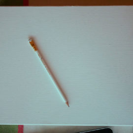 A white canvas and a pencil.