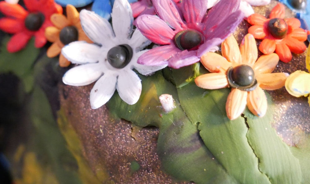 polymer clay flowers and a little piece of bamboo