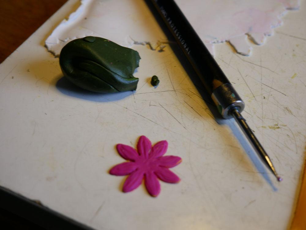 One magenta flower in polymer clay