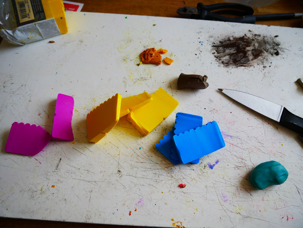 Chunks of polymer clay in magenta, yellow and blue.
