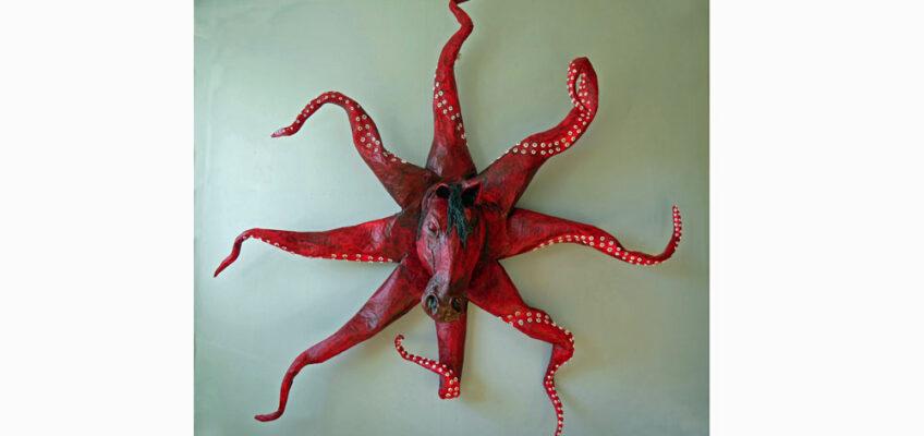 Röd hästskultur som ser ut som en bläckfisk